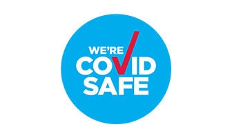 We're Covid Safe blue circular icon on white Background